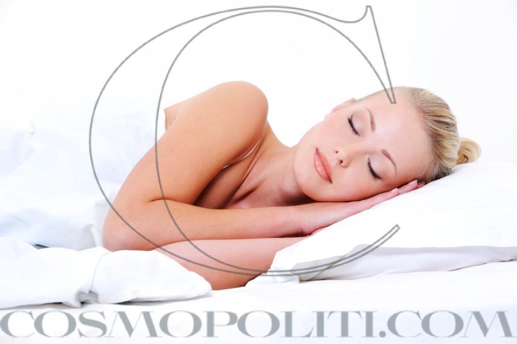 young sleeping woman seeing sweet dreams