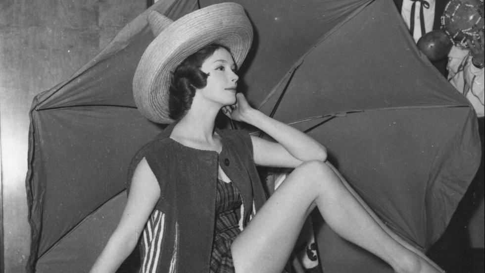 April 1958Margaret Brown models a tartan nylon swimsuit worn under a toweling jacket England.