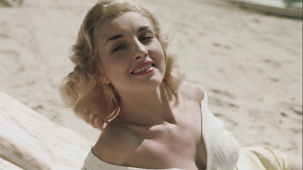 Circa 1955Model Joan Scott is seen wearing a white bathing suit, England