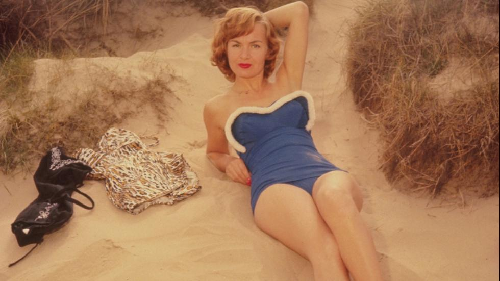 Circa 1956German actress Marianne Brauns, on a beach modeling a swimming costume