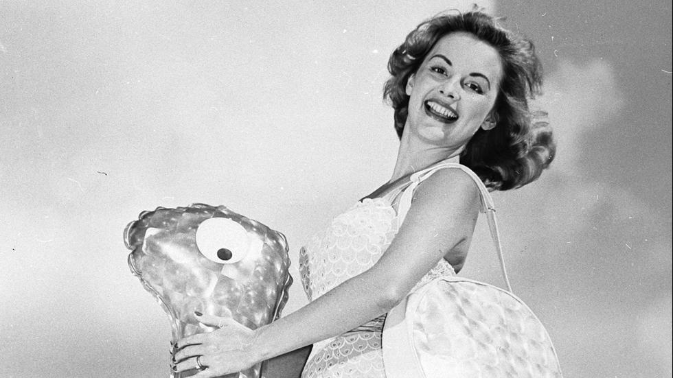Circa 1957Beauty queen LaTricia Heard riding an inflatable beach toy in her role as Florida's Queen of Sunshine