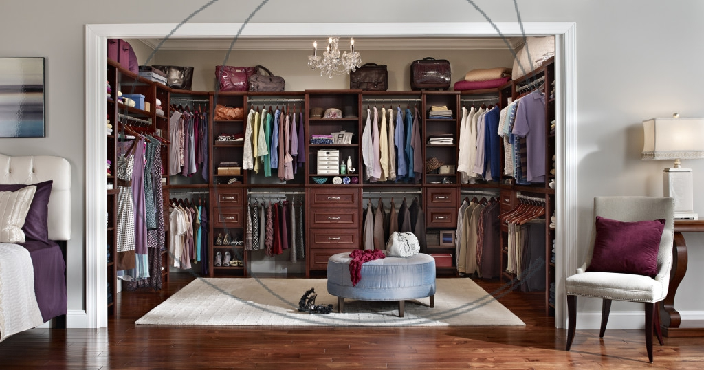 Wonderful-brown-walk-in-closet-design-idea-with-wooden-closet-furniture-includes-colorful-clothes-shoes-and-bags-chandleir-also-blue-pouffe-on-white-rug-and-wooden-floor