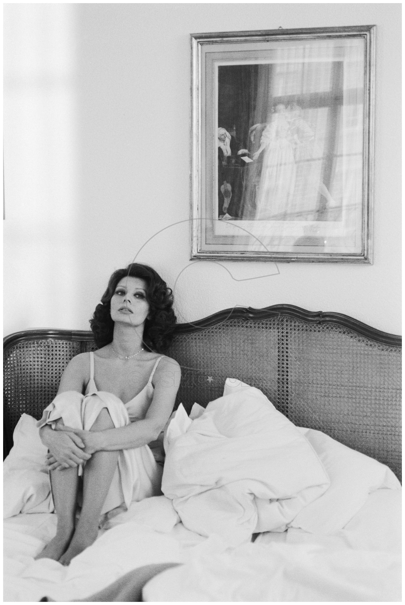Actress Sophia Loren sitting in an unmade bed. (Photo by Terry O'Neill/Getty Images)