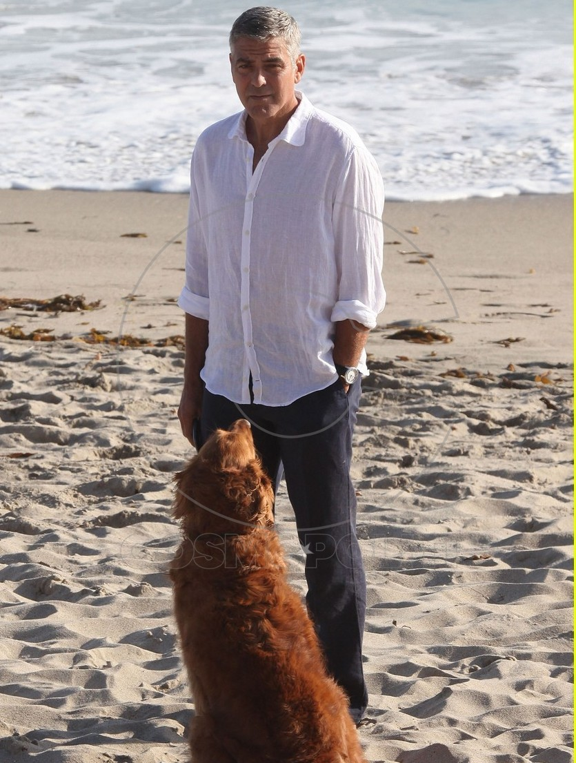 Actor George Clooney enjoying his new best friend on the set of an Italian TV commercial on the beach in Malibu, California on May 15, 2012