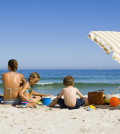 Family relaxing at beach together