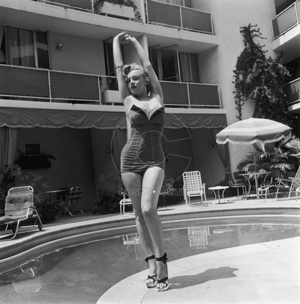 American actress Marilyn Monroe (1926 - 1962) stands next to a swimming pool in a strapless swimsuit and high heels, circa 1951. (Photo by Archive Photos/Getty Images)
