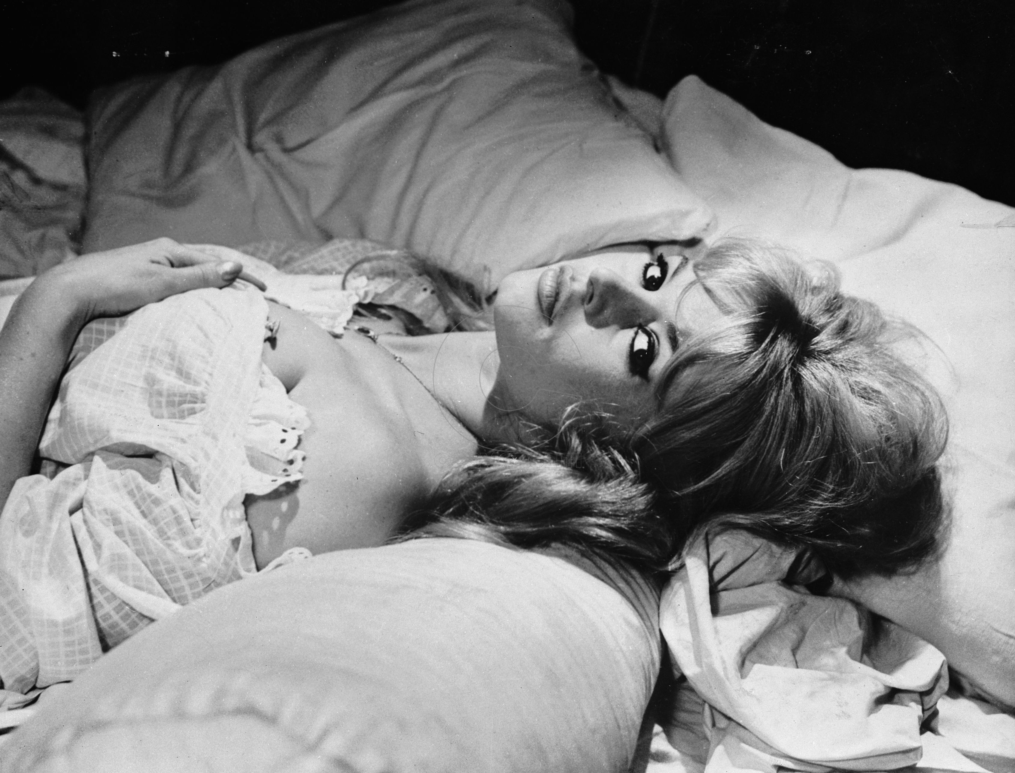 1960: Sultry French actress Brigitte Bardot in bed. (Photo by Keystone Features/Getty Images)
