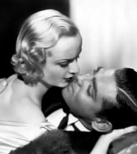 """1932: Carole Lombard and Clark Gable prepare for a screen kiss in a scene from the film, """"No Man of Her Own."""""""