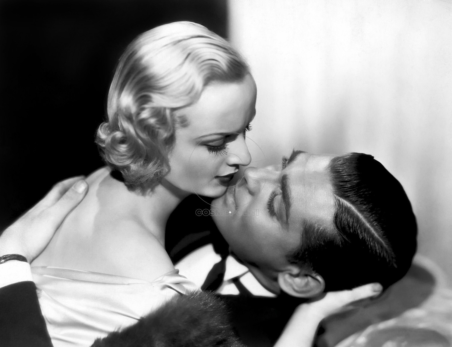 "1932: Carole Lombard and Clark Gable prepare for a screen kiss in a scene from the film, ""No Man of Her Own."""