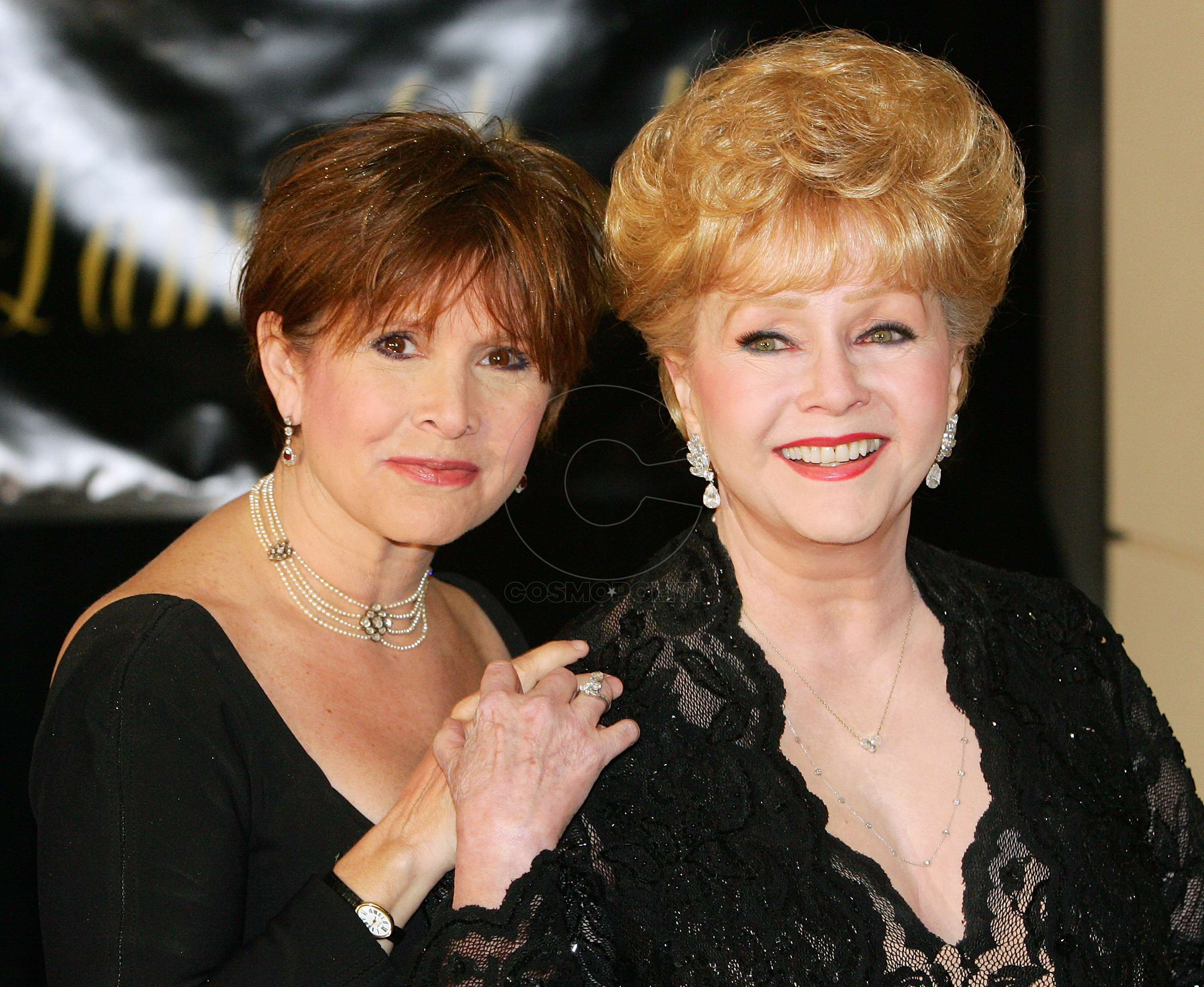 HENDERSON, NV - FEBRUARY 27:  Actress Carrie Fisher (L) and her mother, actress Debbie Reynolds, arrive for Dame Elizabeth Taylor's 75th birthday party at the Ritz-Carlton, Lake Las Vegas on February 27, 2007 in Henderson, Nevada.  (Photo by Ethan Miller/Getty Images)