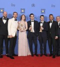BEVERLY HILLS, CA - JANUARY 08: Cast and crew of 'La La Land,' winners of Best Motion Picture - Musical or Comedy, pose in the press room during the 74th Annual Golden Globe Awards at The Beverly Hilton Hotel on January 8, 2017 in Beverly Hills, California.   Kevin Winter/Getty Images/AFP