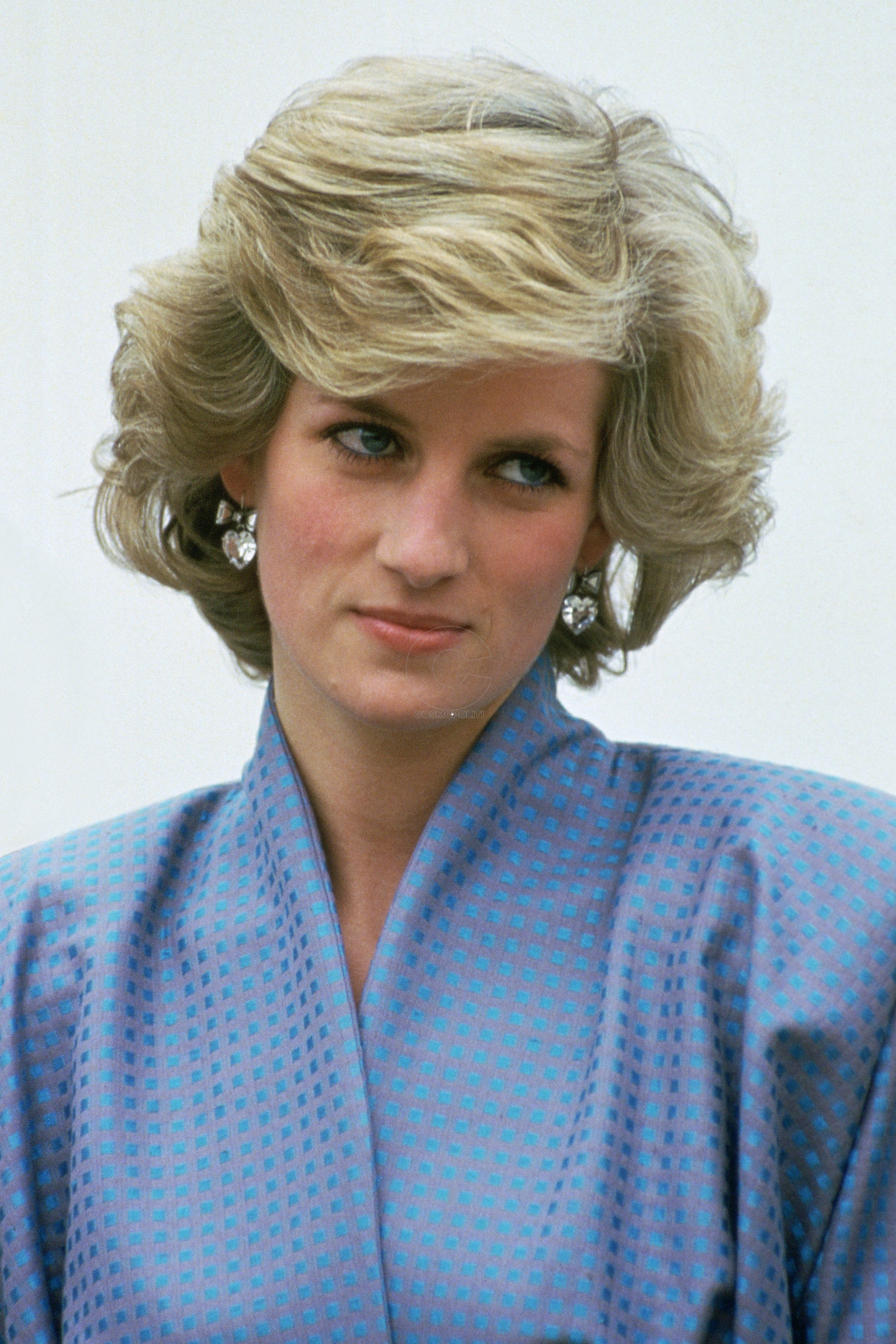 ITALY - APRIL 22: Diana, Princess Of Wales, Wearing A Silk Suit Designed By Fashion Designer Bruce Oldfield, During An Official Overseas Visit. Diana's Crystal Heart Earrings Are By Jewellers Butler And Wilson. (Photo by Tim Graham/Getty Images)