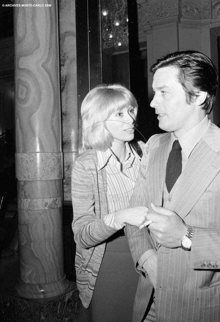 mireille-darc-and-alain-delon-in-the-lobby-of-the-hotel-de-paris-1974-archives-societe-des-bains-de-mer