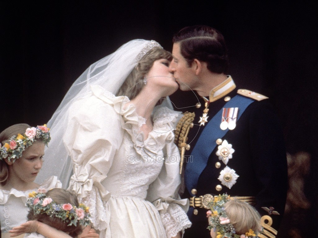 Mandatory Credit: Photo by Reginald Davis / Rex Features ( 811931ca ) On the balcony of Buckingham Palace Prince Charles and Princess Diana kiss on their wedding day Prince Charles 811931ca