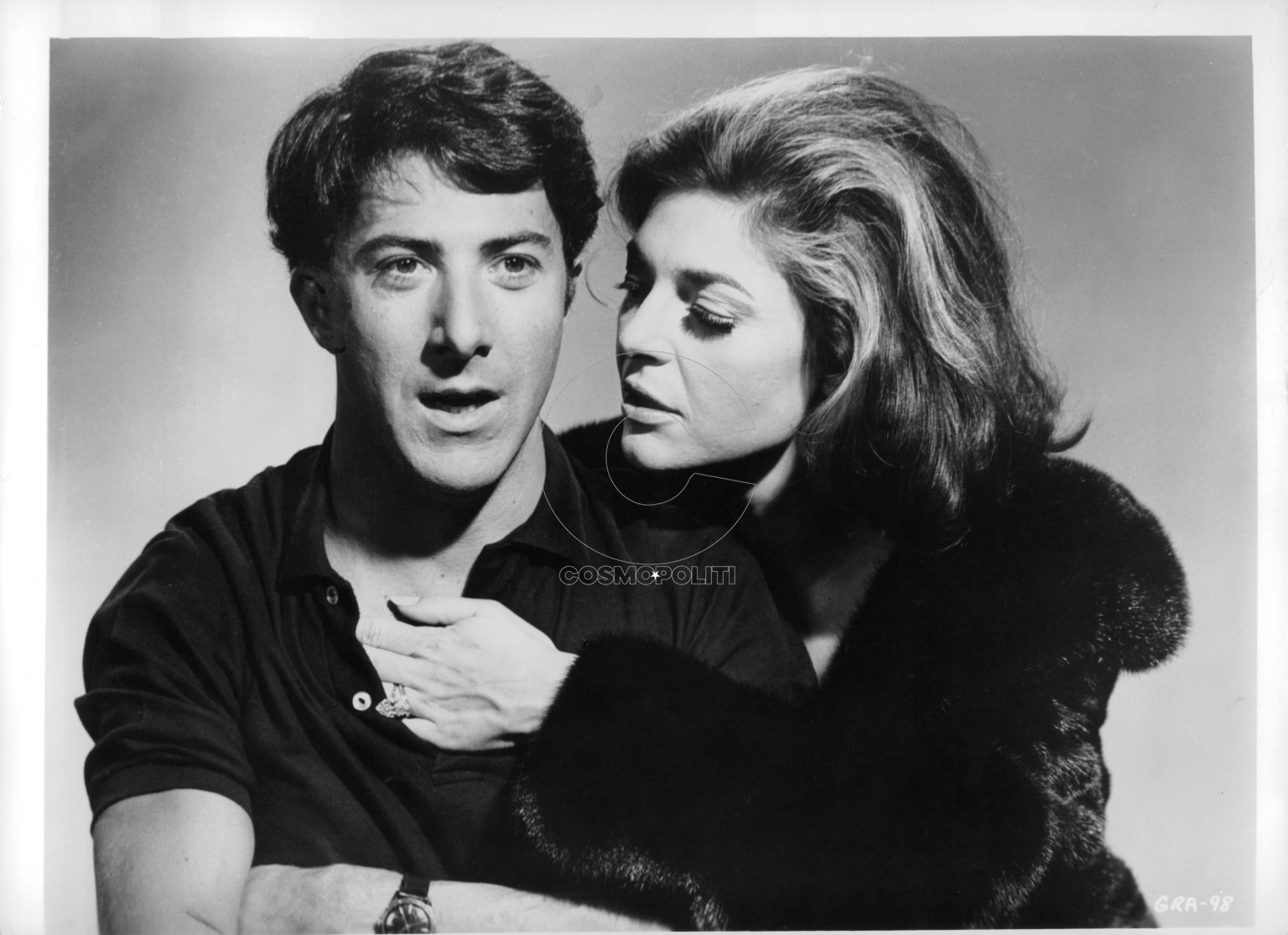 Anne Bancroft reaches into the shirt of Dustin Hoffman in a publicity portrait for the film 'The Graduate', 1967. (Photo by Embassy Pictures/Getty Images)