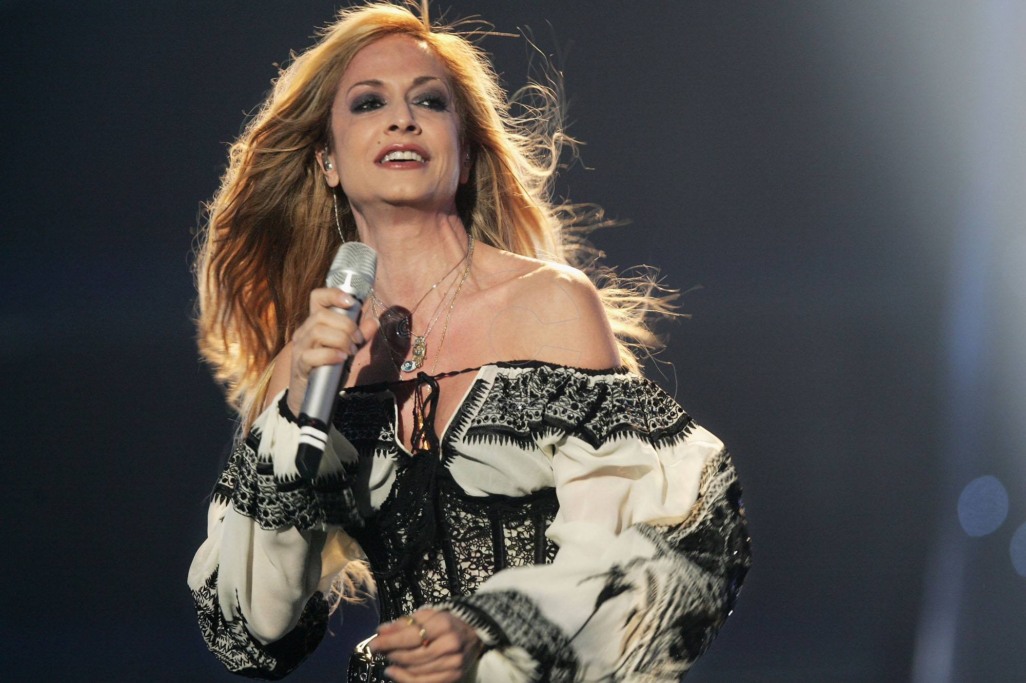 ATHENS - MAY 19: Singer Anna Vissi of Greece performs at the dress rehearsal prior to the finals of the 2006 Eurovision Song Contest May 19, 2006 in Athens, Greece. (Photo by Sean Gallup/Getty Images)