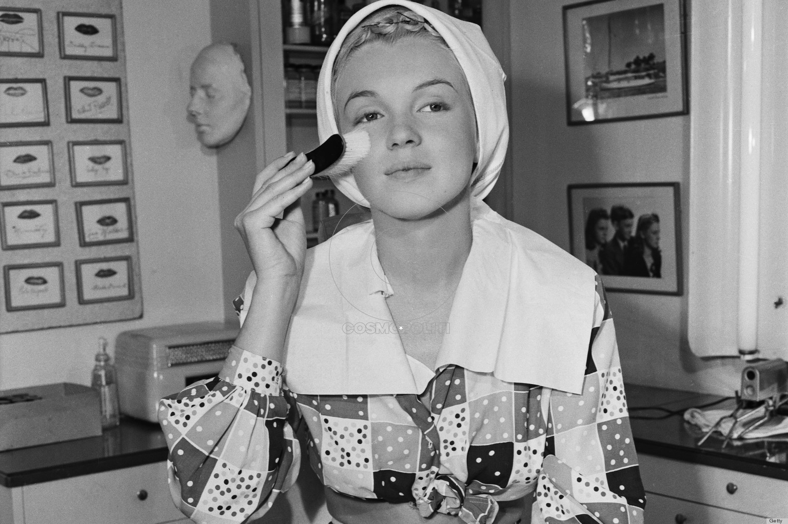 American film star Marilyn Monroe (1926 - 1962) begins the process of applying her make-up, 1948. (Photo by John Kobal Foundation/Getty Images)