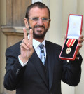 TOPSHOT - Richard Starkey, better knonwn as Ringo Starr, poses with his medal after being appointed Knight Commander of the Order of the British Empire at an investiture ceremony at Buckingham Palace in London on March 20, 2018.  / AFP PHOTO / POOL / John Stillwell        (Photo credit should read JOHN STILLWELL/AFP/Getty Images)