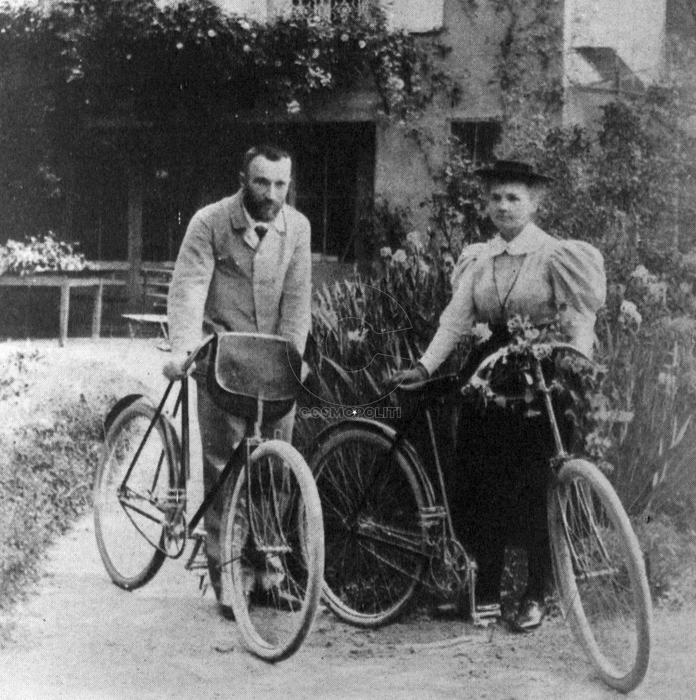 Pierre and Marie Curie with their bicycles.
