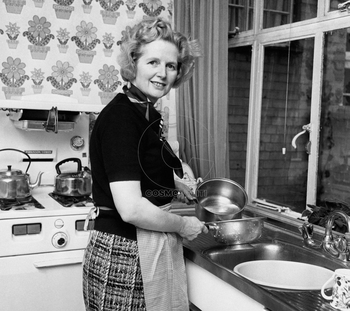 UNITED KINGDOM OUT NO SALES NO ARCHIVE PHOTOGRAPH CAN NOT BE STORED OR USED FOR MORE THAN 14 DAYS AFTER THE DAY OF TRANSMISSION FEB, 1, 1975 FILE PHOTO FILE _ This is a Feb, 1, 1975 file photo of the them Conservative Member of Parliament Margaret Thatcher, in her Chelsea home kitchen. Former British Prime Minister Margaret Thatcher, whose conservative ideas made an enduring impact on Britain died Monday April 8, 2013. She was 87. (AP Photo/ PA/File) UNITED KINGDOM OUT NO SALES NO ARCHIVE