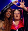 Cyprus's Eleni Foureira and Israel's Netta react after the Semi-Final 1 for Eurovision Song Contest 2018 at the Altice Arena hall in Lisbon, Portugal, May 8, 2018. REUTERS/Pedro Nunes