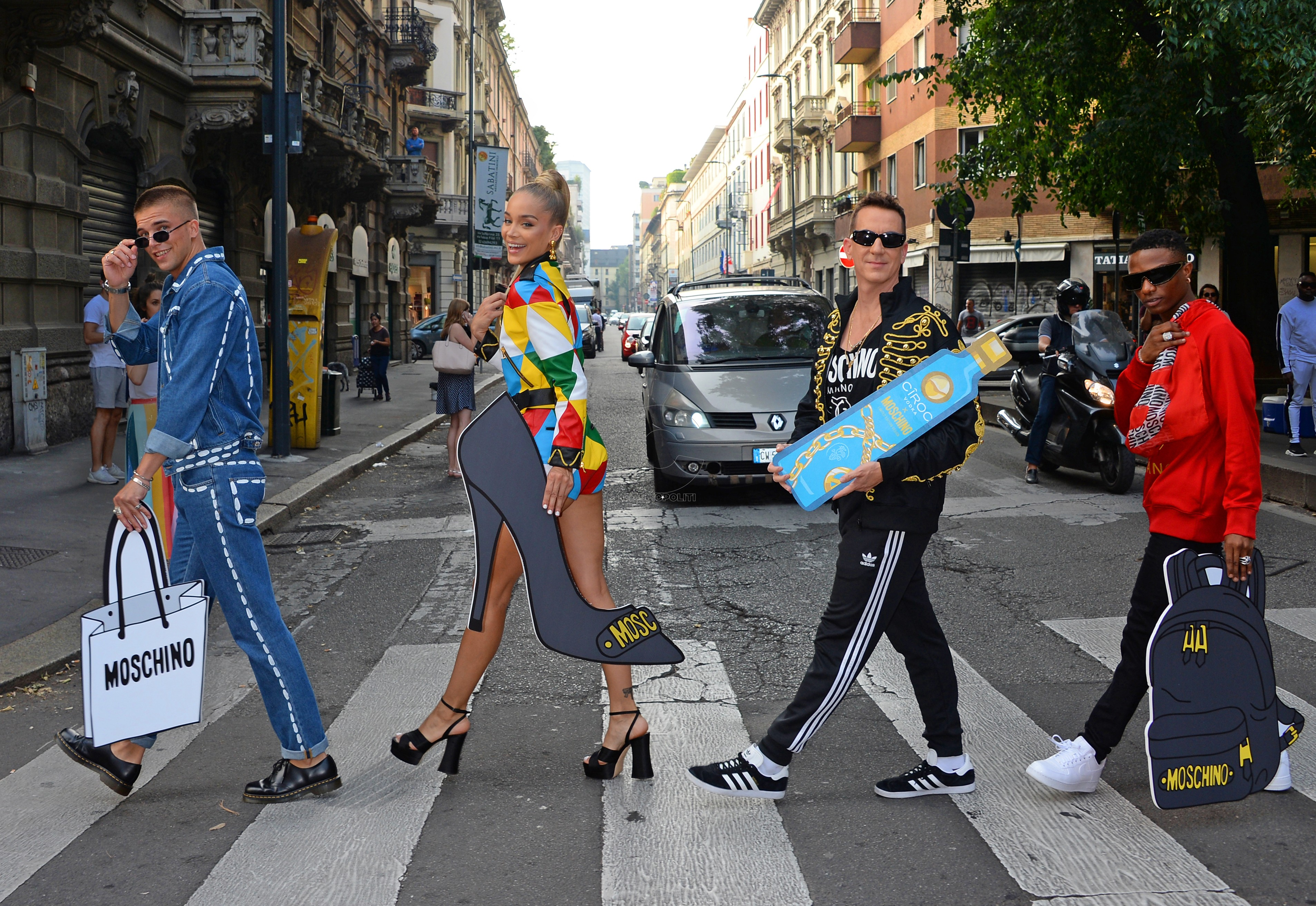 MILAN, ITALY - SEPTEMBER 19: (L to R) River Viiperi, Jasmine Sanders aka Golden Barbie, Jeremy Scott and WizKid stop traffic launching the CIROC x Moschino collaboration during Milan Fashion Week in the centre of Milan. CIROC luxury vodka has partnered with Italian fashion house Moschino, bringing together fashion's most playful brands. Pi Credit: Dave Benett