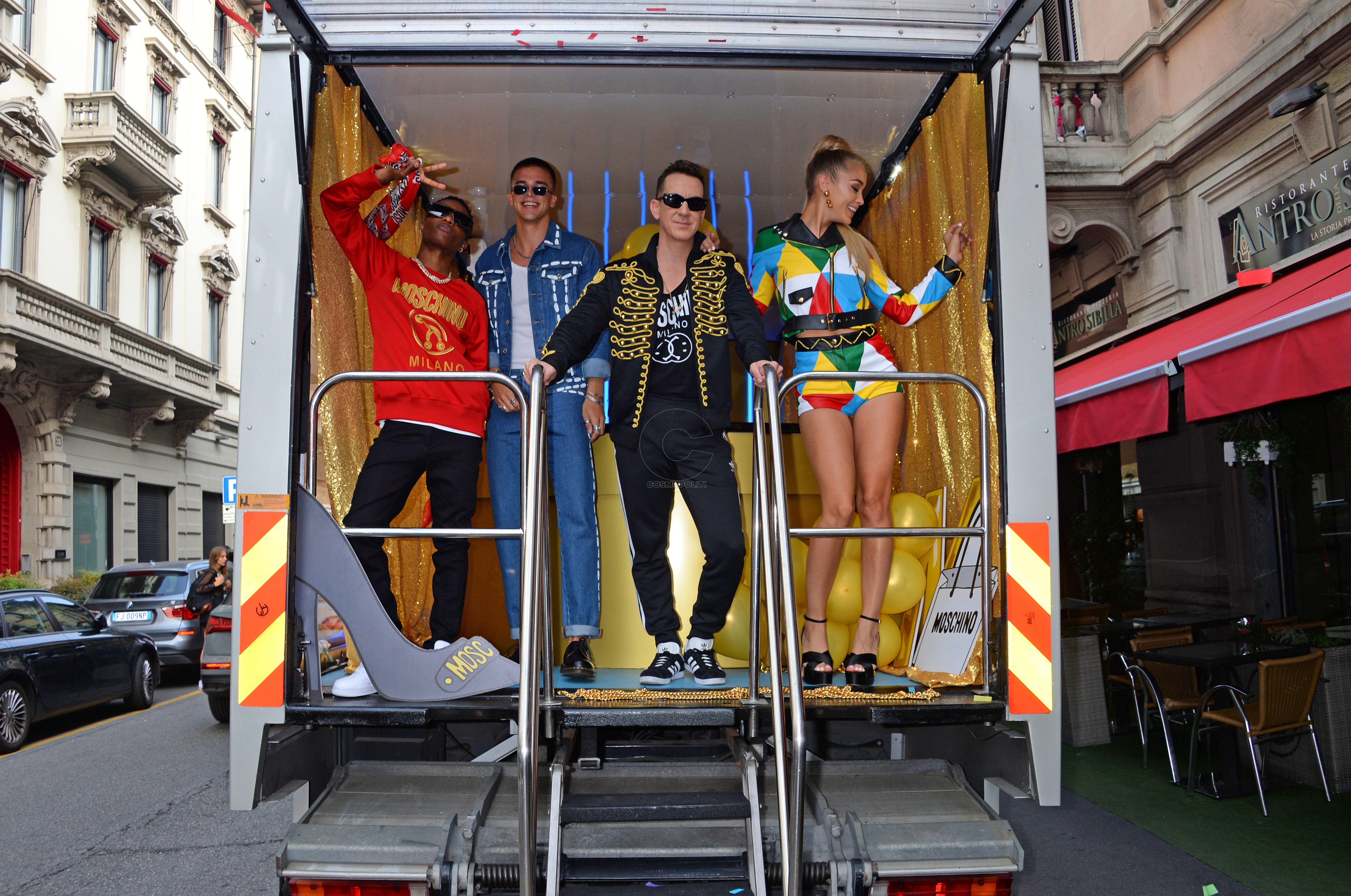 MILAN, ITALY - SEPTEMBER 19: (L to R) WizKid, River Viiperi, Jeremy Scott and Jasmine Sanders aka Golden Barbie launch the CIROC x Moschino collaboration during Milan Fashion Week aboard the CIROC truck in the centre of Milan. CIROC luxury vodka has partnered with Italian fashion house Moschino, bringing together fashion's most playful brands. Pi Credit: Dave Benett