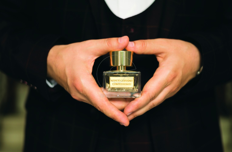 Manos Gerakinis holding Quintessence from Haute Parfums MEd