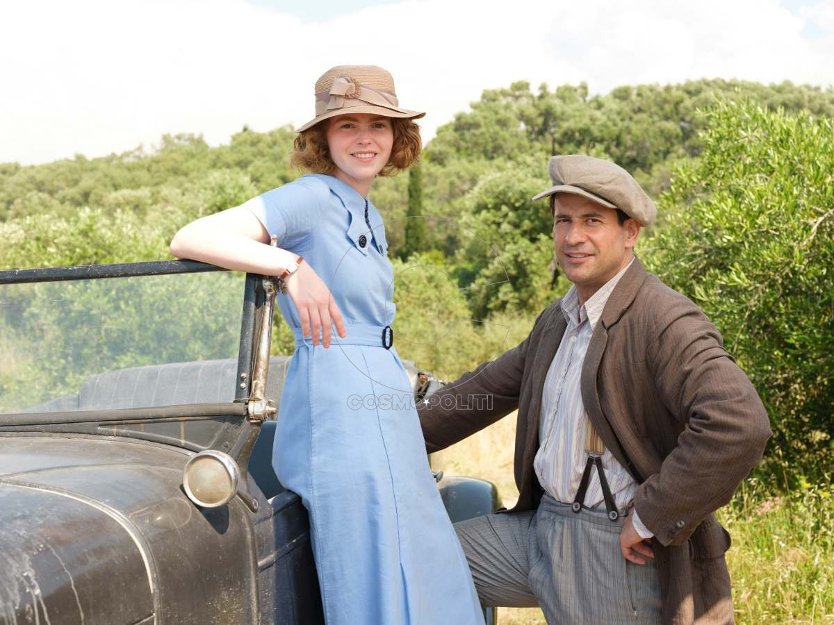 Sid Gentle Productions THE DURRELLS Series 3 on ITV Episode 3 Pictured: DAISY WATERSTONE as Margo Durrell and ALEXIS GEORGOULIS as Spiro Hakaiopulos. This photograph is (C) SID GENTLE PRODUCTIONS/iTV and can only be reproduced for editorial purposes directly in connection with the programme or event mentioned above. Once made available by ITV plc Picture Desk, this photograph can be reproduced once only up until the transmission [TX] date and no reproduction fee will be charged. Any subsequent usage may incur a fee. This photograph must not be manipulated [excluding basic cropping] in a manner which alters the visual appearance of the person photographed deemed detrimental or inappropriate by ITV plc Picture Desk.  This photograph must not be syndicated to any other company, publication or website, or permanently archived, without the express written permission of ITV Plc Picture Desk. Full Terms and conditions are available on the website www.itvpictures.com For further information please contact: Patrick.smith@itv.com 0207 1573044