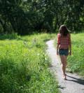 Girl walking on summer path