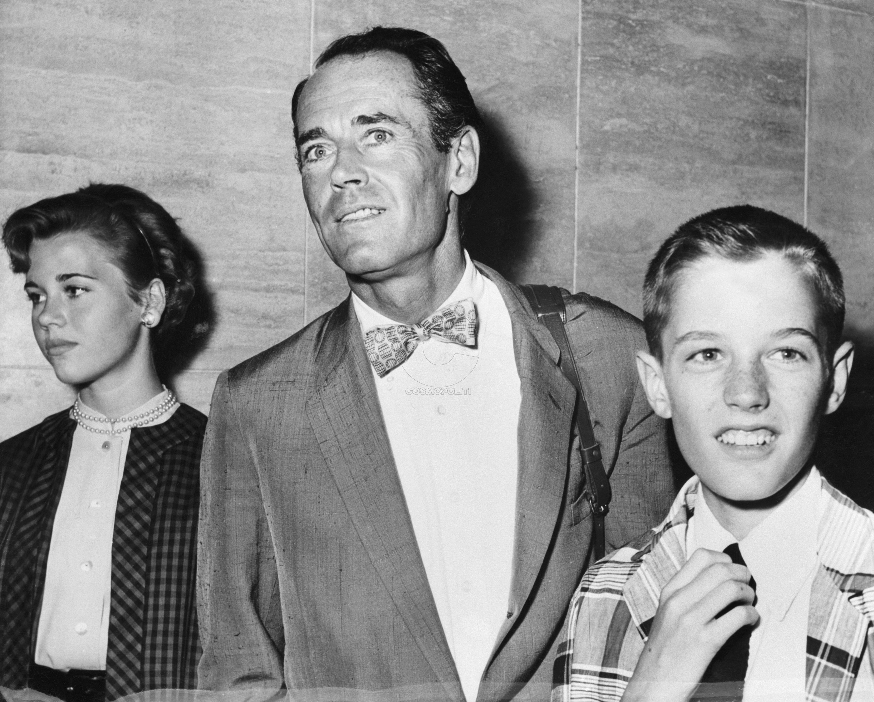 "(Original Caption) 7/13/1955-Rome, Italy-Actor Henry Fonda arrives in Rome with his daughter Jane and son Peter to begin a movie assignment. He'll co-star with Audrey Hepburn in the multi-million dollar production of ""War and Peace."" Fonda wanted the kids with him during the four months he'll be in the Eternal City."