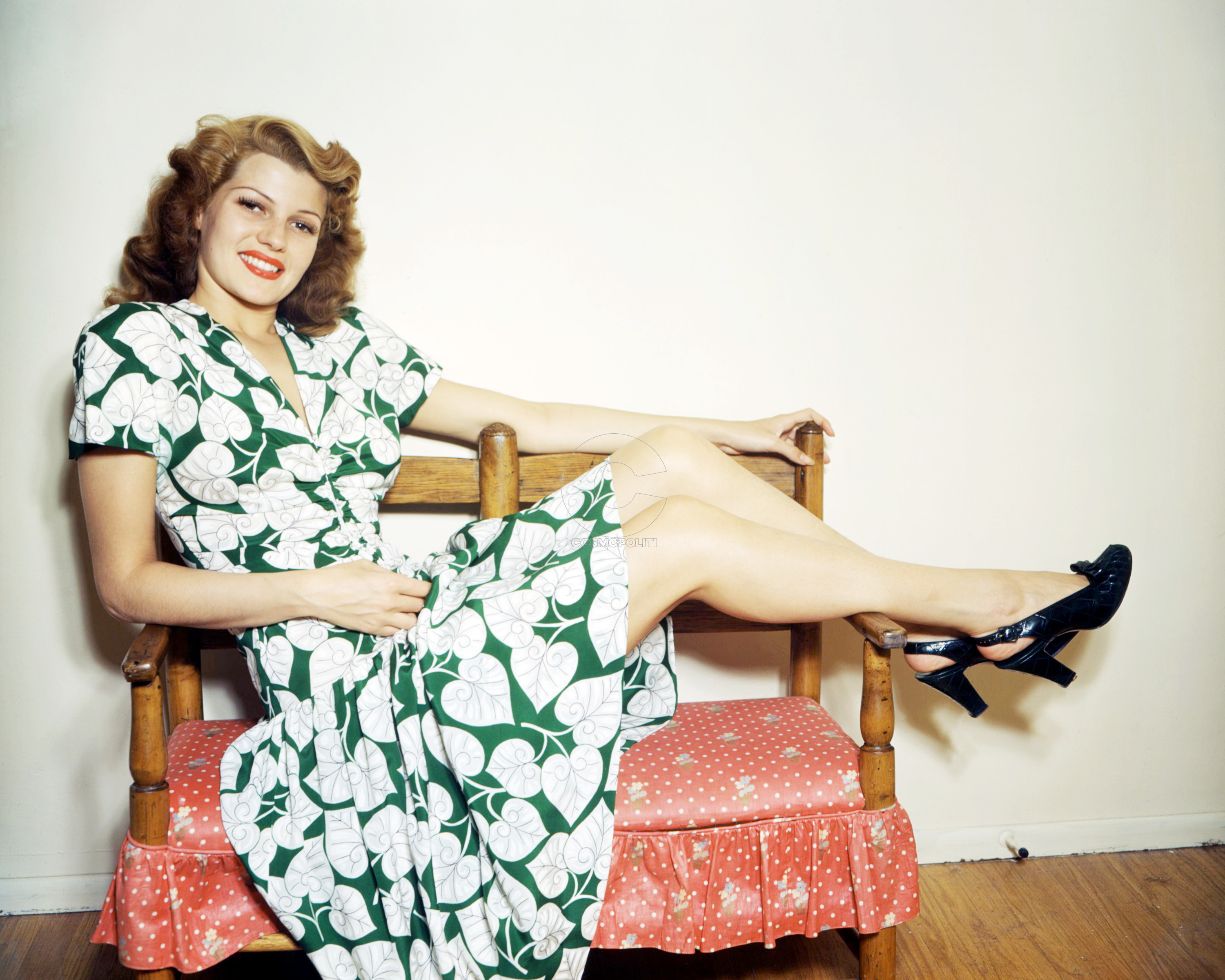 American actress Rita Hayworth (1918 - 1987) wearing a green and white, leaf-patterned dress and putting her feet up, circa 1945. (Photo by Silver Screen Collection/Getty Images)