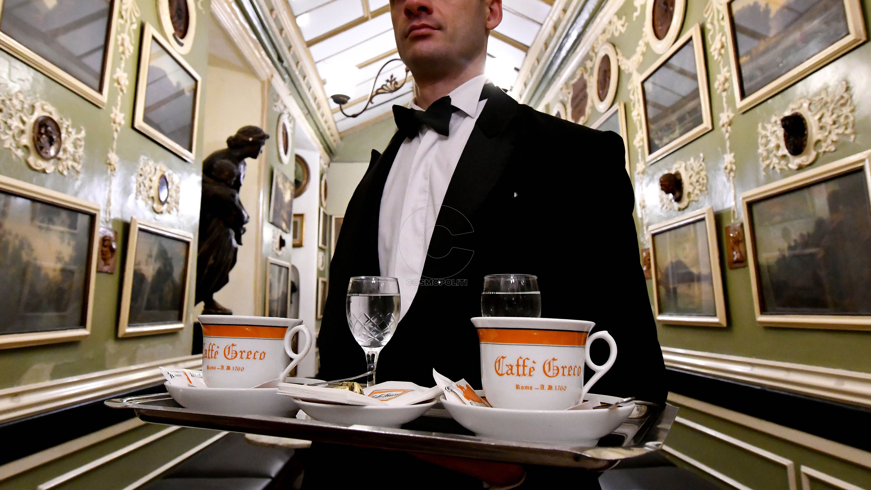 A waiter carries coffees in the Antico Caffe Greco, in Via dei Condotti, central Rome on January 15, 2018. The Caffe Greco, founded in 1760 by Greek Nicola della Maddalena, is the second oldest coffee in Italy after the Caffe Florian in Venice.