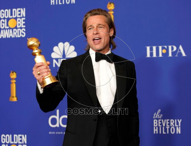 """77th Golden Globe Awards - Photo Room - Beverly Hills, California, U.S., January 5, 2020 - Brad Pitt poses backstage with his award for Best Performance by an Actor in a Supporting Role in any Motion Picture for """"Once Upon a Time...in Hollywood."""" REUTERS/Mike Blake"""
