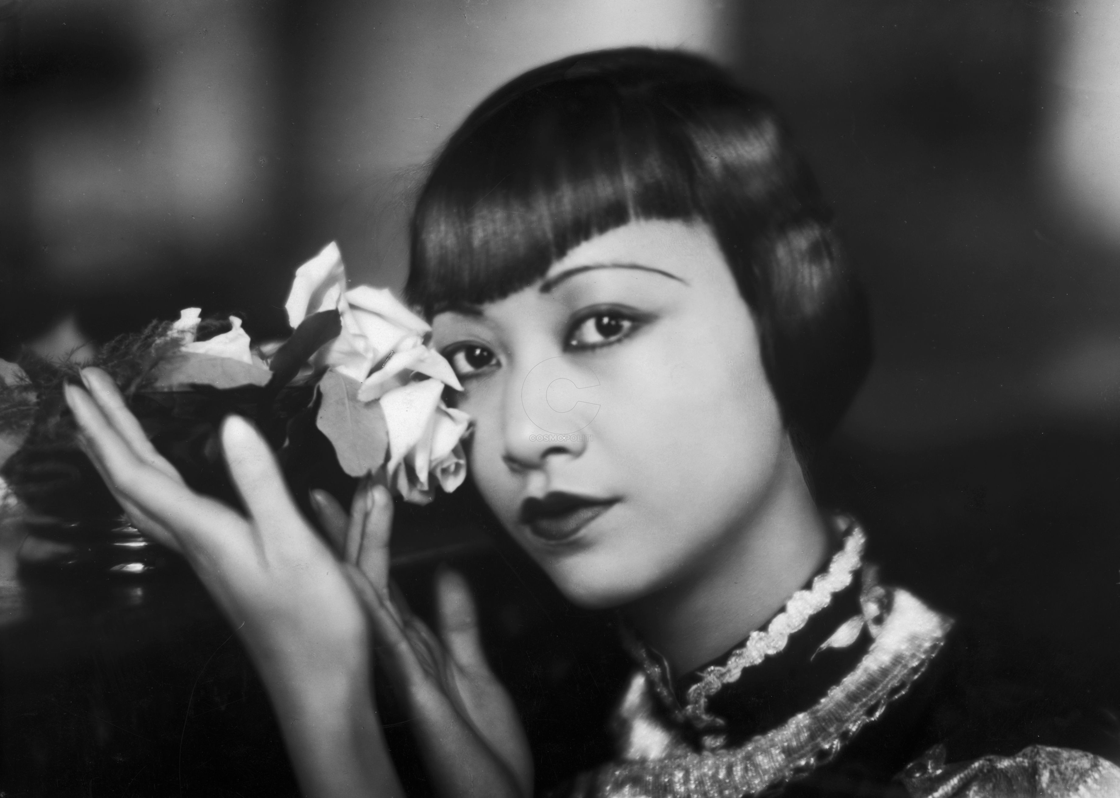 american-film-star-anna-may-wong-poses-with-a-cut-rose-news-photo-1588260248